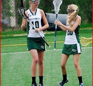 Seniors Devon Hoffman and Allie Kenny give each other a pep talk to get through a varsity lacrosse game as freshmen.