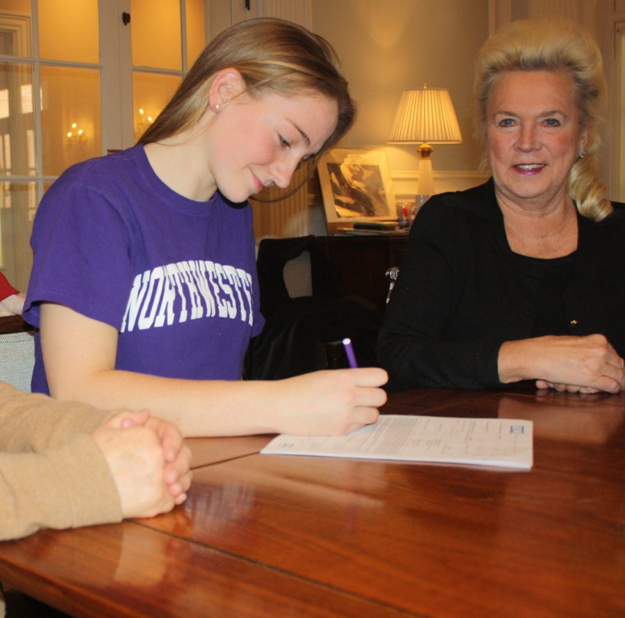 Jenna+Hascher%2C+alongside+Mrs.+Collins+and+Mrs.+Hayes%2C+signed+a+National+Letter+of+Intent+to+play+soccer+for+Northwestern+University+on+February+6.%0AAlison+Brett+%2713