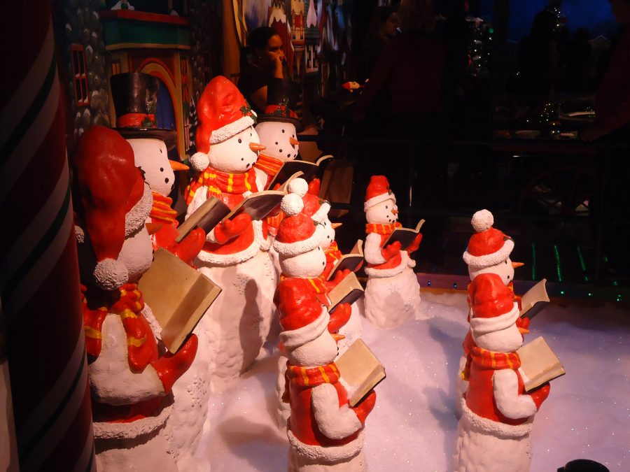Even these snowmen at Macy's Santaland® have to study during the Christmas season. Zsanelle Morel '15