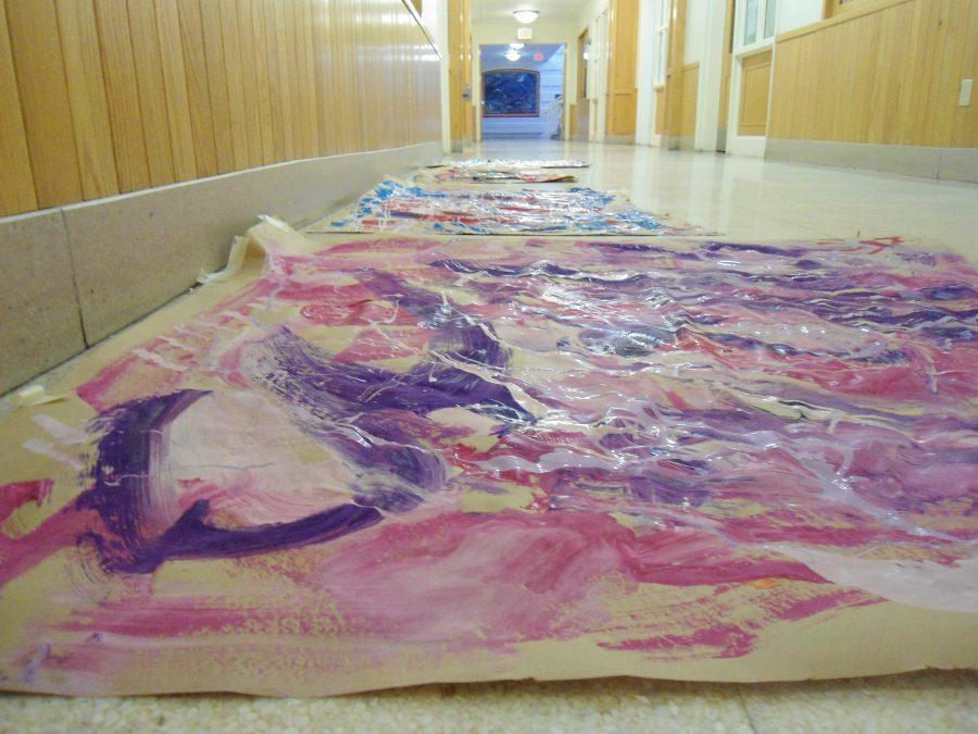 A+few+of+the+paintings+created+by+Mrs.+Paula+Westcott%27s+Art%2C+Advanced+Portfolio%2C+and+Drawing+and+Painting+classes%2C+with+special+guest+Carmen+Lund%2C+dry+in+the+science+wing+hallway.+