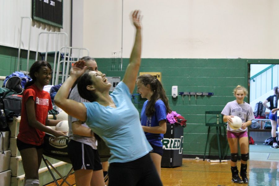 Varsity+volleyball+coach+Carolina+Herrera+serves+a+ball+to+her+players+with+a+smile.%0AIzzy+Sio+%2716