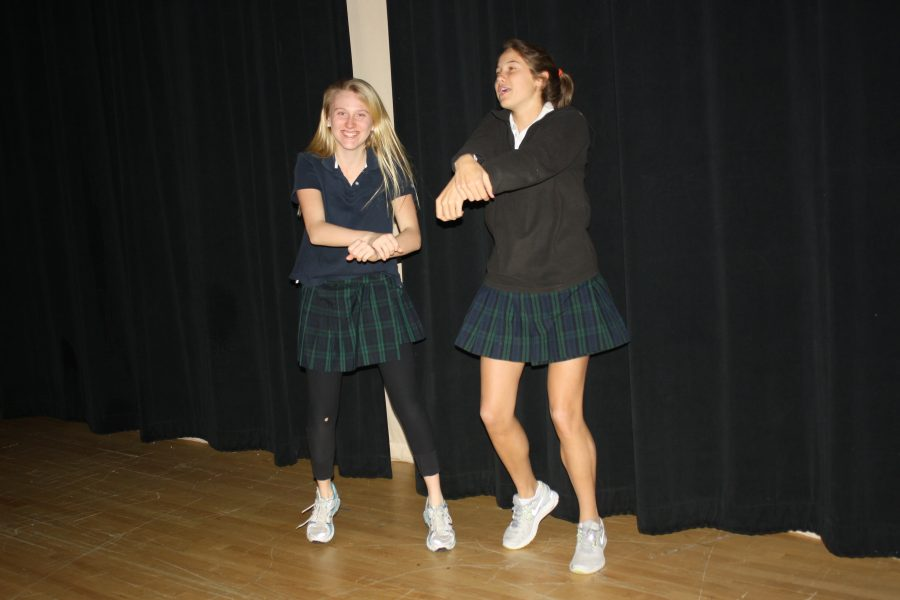 Sophomores Caroline Burch and Emma Church perform the dance to Korean artist PSY's
