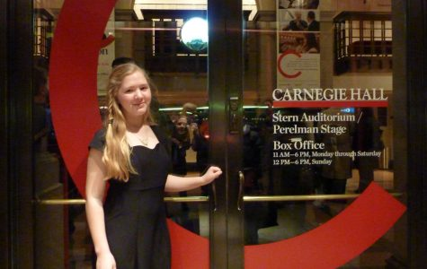 Convent of the Sacred Heart freshman Brooke Remsen, wearing the Manhattan Girls' Chorus's signature butterfly necklace, performed with the group at Carnegie Hall February 27. Courtesy of Brooke Remsen '16.