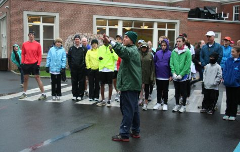 Convent of the Sacred Heart cross country coach Brad Miller helps line up runners at the start of the 2012 race.