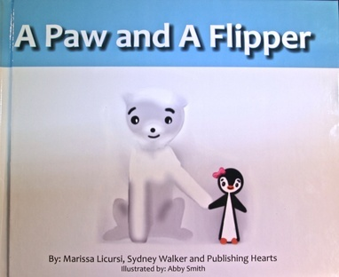 A Paw and a Flipper is now available for purchase on amazon.com. courtesy of Marissa Licursi '14