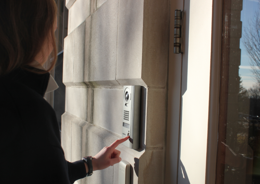 With the addition of the new intercom and camera system, students must wait to be buzzed inside the building by a security member. Sarah Jackmauh '15