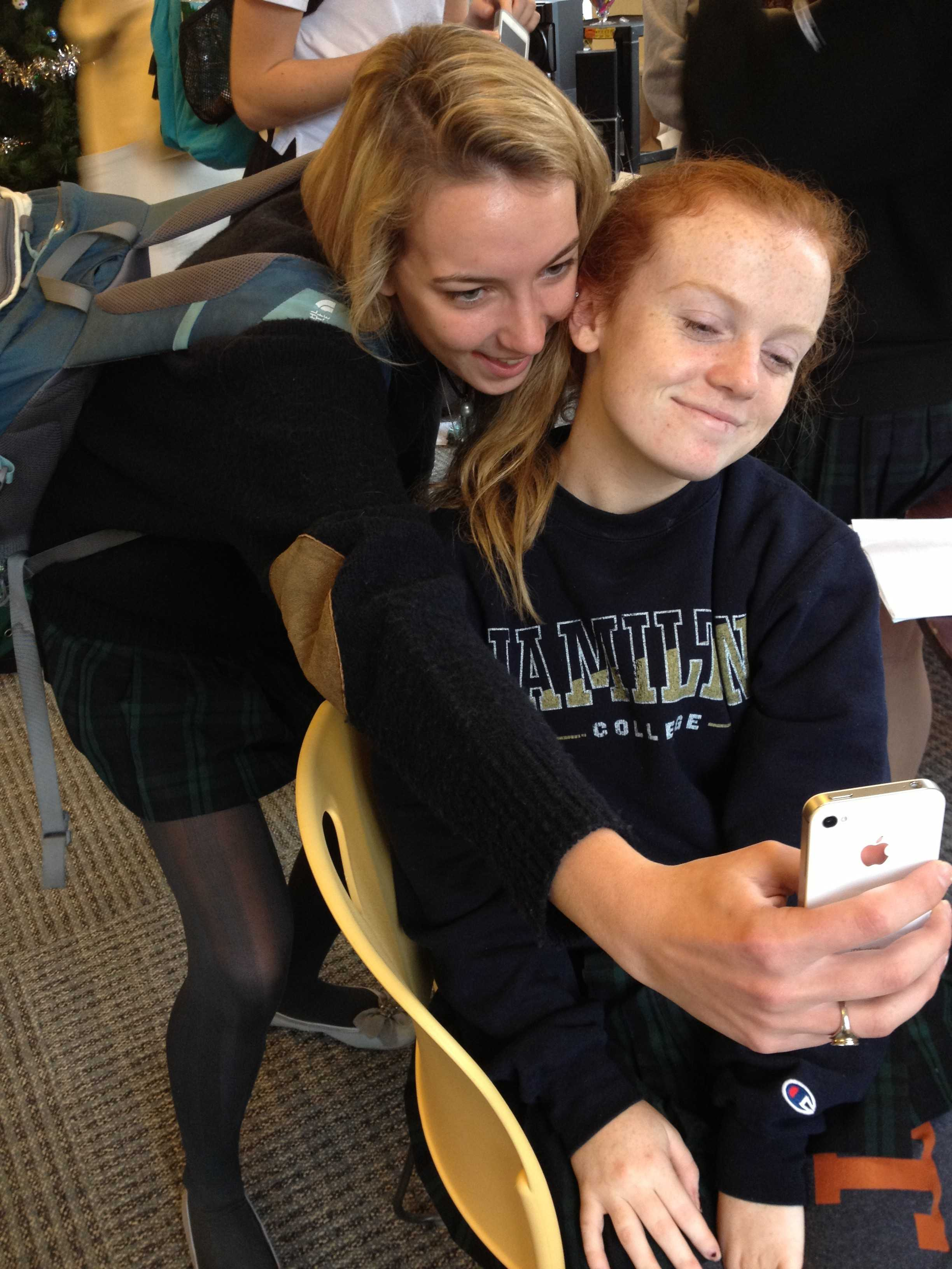 Seniors Marguerite Sommer and Taylor Ryan make silly faces for a Snapchat photo, as many teenagers today do. Allie Kenny 13