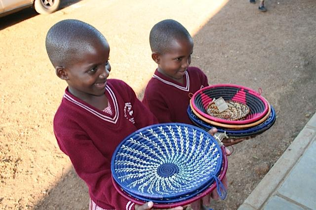 Two+attendees+of+the+Sacred+Heart+primary+school+of+Uganda+have+increased+hope+for+the+future+because+they+receive+full+educations.++