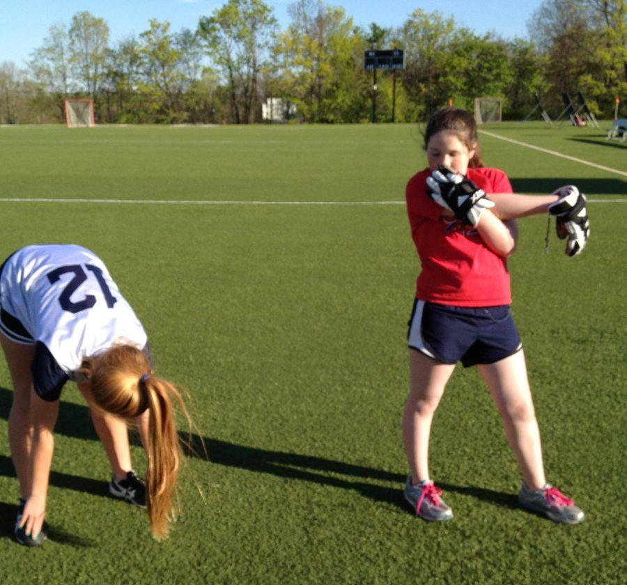 Freshmen+Lucy+Alderson-Smith+and+Elizabeth+Considine+stretch+before+lacrosse+practice.%0Acourtesy+of+Maddie+Caponiti+%2715
