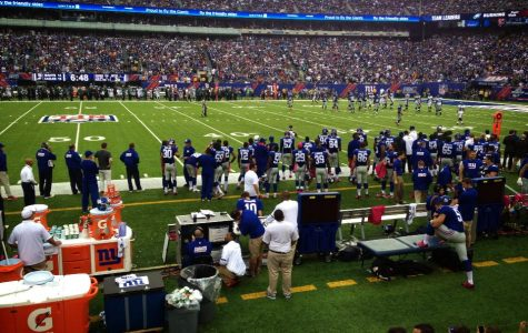 The New York Giants prepare for their football game aganist the Philadelphia Eagles. The athletic trainor is talking to quarterback Eli Manning. Maddie Caponiti '15