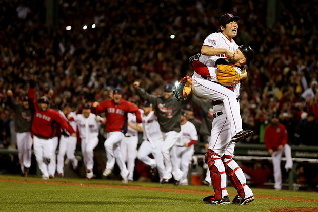 After+striking+out+Cardinals%27+final+batter+Matt+Carpenter%2C+Boston+Red+Sox+pitcher+Koji+Uehara+leaps+into+the+arms+of+catcher+David+Ross+as+the+Red+Sox+win+the+World+Series+Championship.+Photo+courtesy+of+Rob+Carr%2FGetty+Images