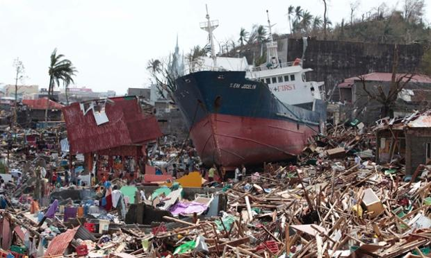 Survivors+of+the+typhoon+search+for+supplies+amongst+a+ship+washed+ashore+in+Tacloban+City%2C+Leyte%2C+located+in+the+Philippines.%0ACourtesy+of+thegaurdian.com