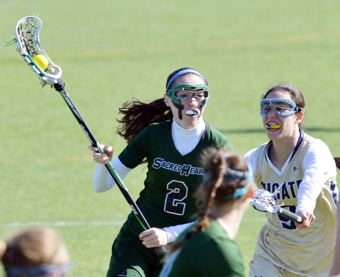 Colleen defends her home turf in a lacrosse game against Choate. Courtesy of ctpost.com