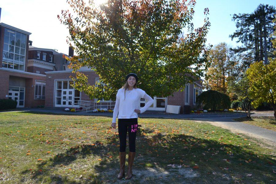 Sophomore Grace Sutherland models one of fall's newest seasonal colors. Her white sweater is a versatile option that can be paired with a diverse amount of autumn hues. Julia Perry '15