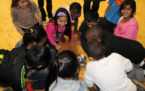 Four Sacred Heart students helped lead a robotics workshop for children ages six through 12 at the Carver Center. Courtesy of Mr. Karl Haesler