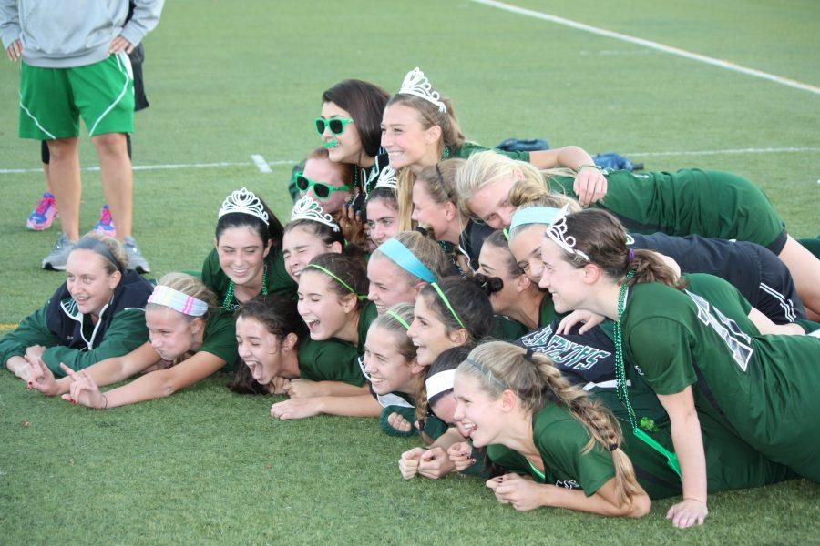 Varsity+field+hockey+players+pile+on+top+of+each+to+celebrate+their+6-0+victory+against+St.+Lukes.%0ACourtesy+of+Gillian+Millerchip