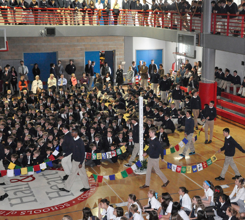 Students of Stuart Hall High School carry the prayer flags through the Herbert Center Gym in celebration of the 100th year anniversary of the death of Janet Erskine Stuart, Religious of the Sacred Heart. Courtesy of Convent of the Sacred Heart Schools, San Francisco, www.sacredsf.org