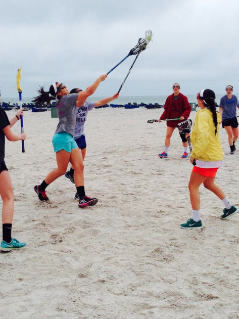 The lacrosse team developed their communication skills by playing a mini game of lacrosse on the beach. Courtesy of Alex Foley '15