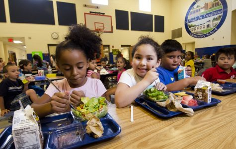 School lunch staff and students enjoy the new menu of fresh and healthy options at Yorkshire Elementary School in Manassas, VA. Courtesy of Lance Cheung, breadfortheworld.org