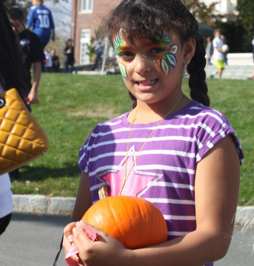 A+lower+schooler+picks+a+pumpkin+at+the+Fall+Family+Festival+October+18.%0AElizabeth+Bachmann+%2717