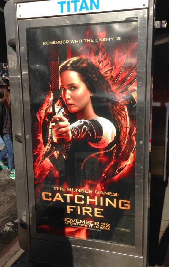 The+Hunger+Games+heroine+Katniss+Everdeen+%28Jennifer+Lawrence%29%2C+portrayed+on+one+of+Catching+Fire%27s+countless+advertisements+on+a+New+York+City+bus+stop.%0AIzzy+Sio+%2716