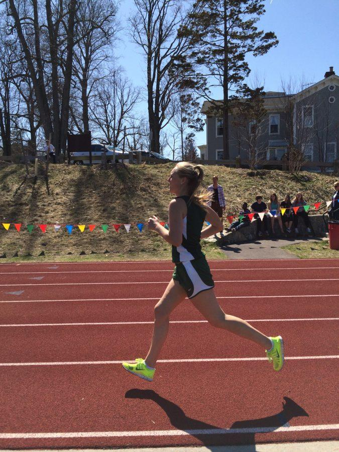 Junior+Liesl+Hennig+approaches+the+finish+line+after+completing+her+800m+leg+of+the+sprint+medley+relay+at+The+Masters+School%2C+April+12.+Sarah+Jackmauh+%2715+