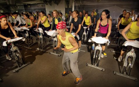 Instructor Stacey Griffith motivates cyclers throughout the 45 minute class. Courtesy of Soul Cycle