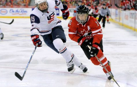 The United States women's hockey team played a strong game against the Canadian women's hockey team. Courtesy of <em>bussinessinsider.com</em>