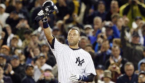 New York Yankee Derek Jeter waves to the crowd at Yankee stadium.