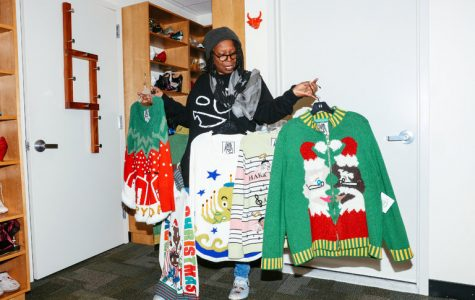 Mrs. Goldberg shows off her new nine Christmas sweater designs. Courtesy of The New York Times