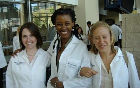 Dr. Alexandra Lewis '01 stands with her classmates at the University of Pittsburgh Medical Center in her first year of medical school. Courtesy of Alexandra Lewis '01
