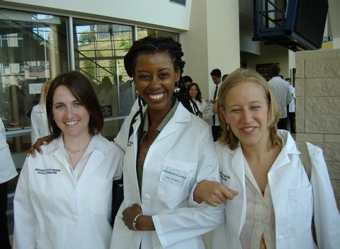 Dr. Alexandra Lewis 01 stands with her classmates at the University of Pittsburgh Medical Center in her first year of medical school. Courtesy of Alexandra Lewis 01