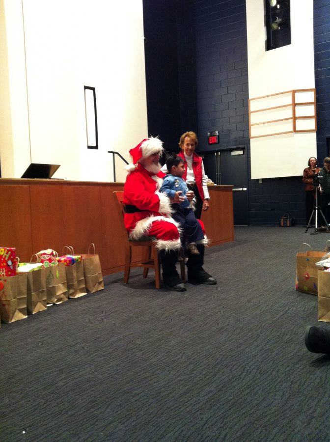 A+Carver+Center+child+prepares+to+receive+his+gifts+on+Santa%27s+lap+during+last+year%27s+Christmas+party.%0ACourtesy+of+Mrs.+Lori+Wilson