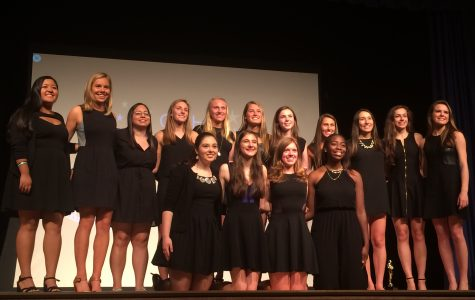 Broadcast Journalism seniors Natalie Ponce, Grace Kennedy, Gabby Lopez, Katie Hill, Caroline Burch, Maddie Church, Alana Normile, Jorden Cohen, Emily Sabia, Grace McKenney, Claren Hesburgh, Jen Esposito, Gabrielle Giacomo, Mary Grace Henry, and Jessica Johnson take a final bow at the end of the Film Festival. Courtesy of Grace Kennedy '15