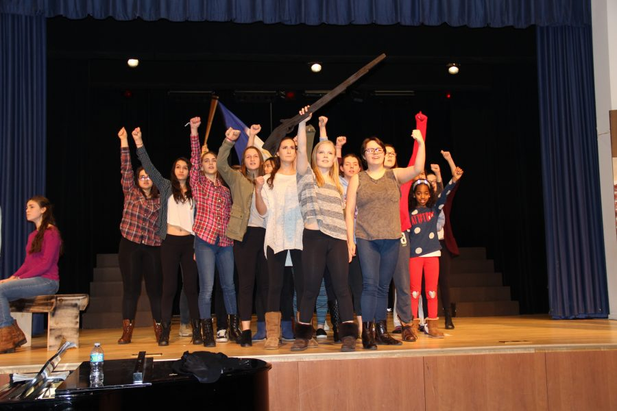 The cast of Les Miserables performs One Day More, with Enjolras, played by Sacred Heart senior Lydia Currie, leading the charge.