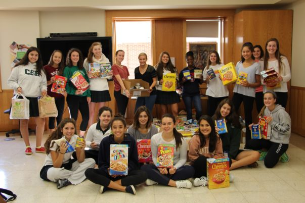 Sacred+Heart+students+with+their+donations+of+cereal+and+pasta.%0AKatie+McCabe+%2718