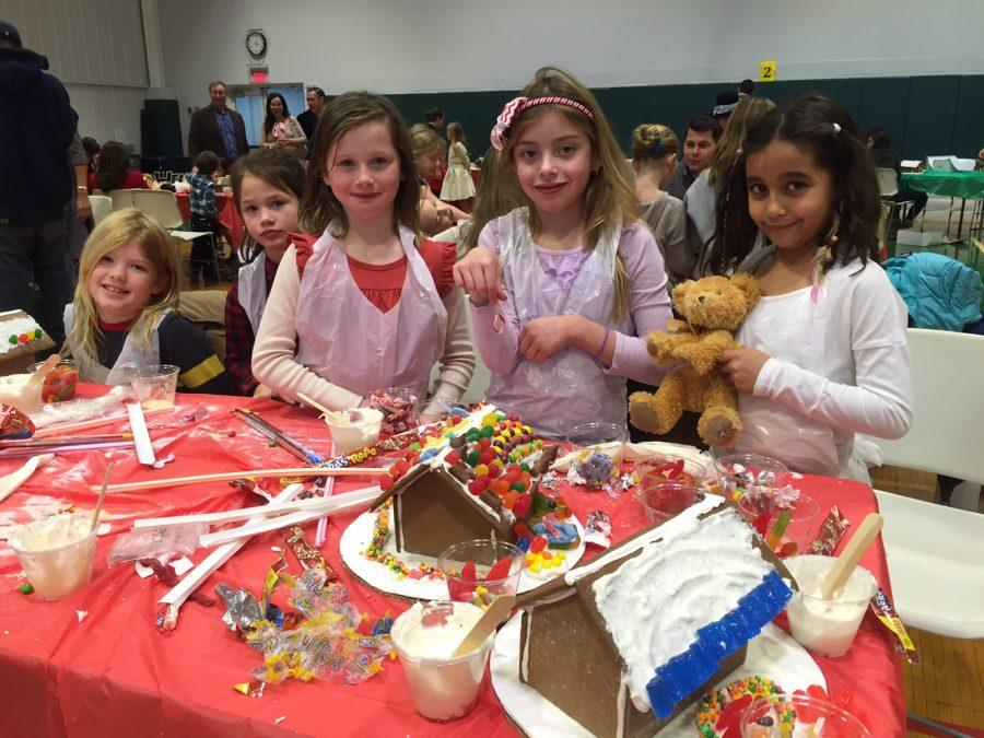 Sacred+Heart+students+decorating+their+gingerbread+houses+at+Come+Home+for+Christmas.%0AKatie+McCabe+%2718