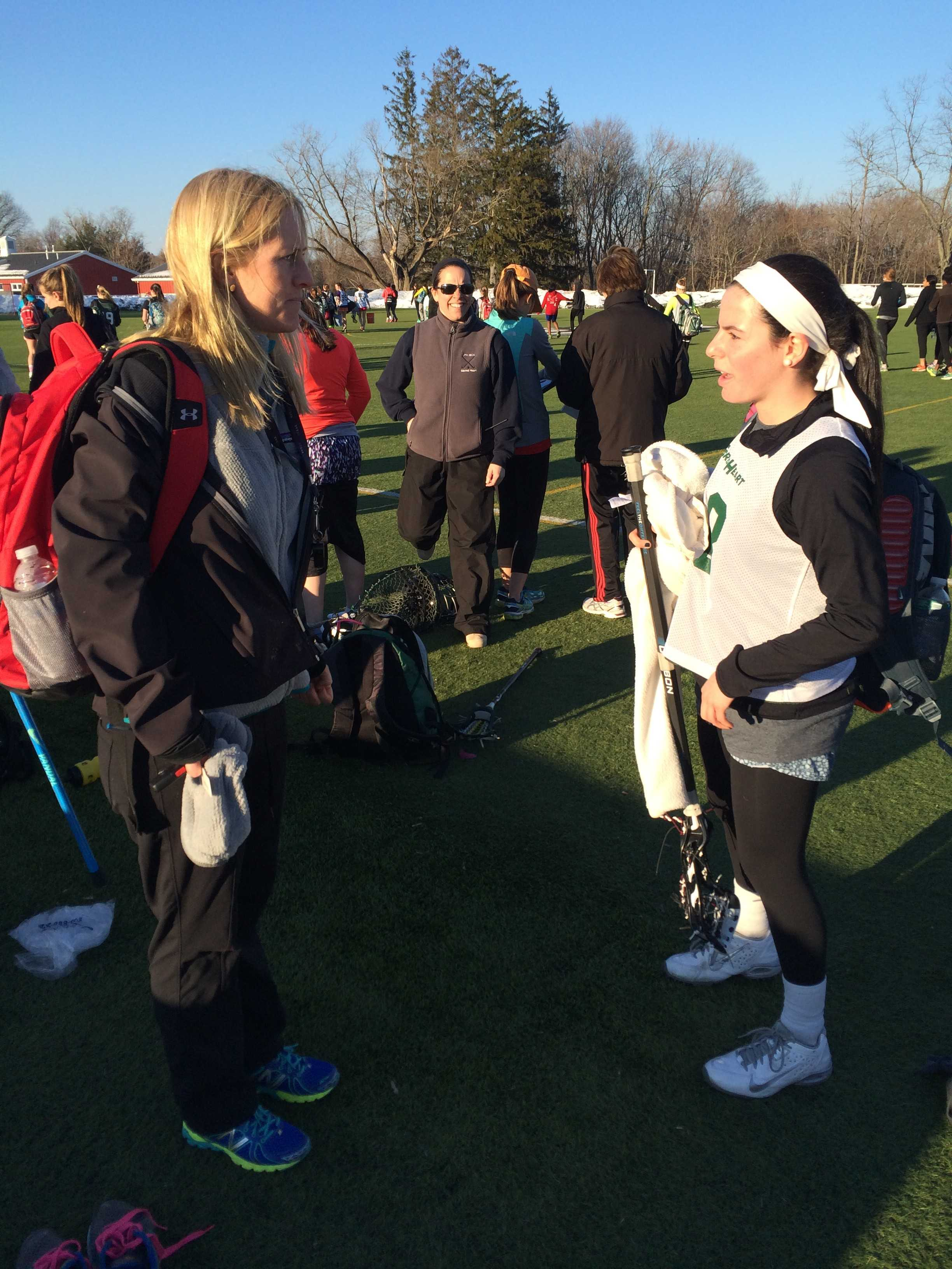 New head varsity lacrosse coach, Mrs. Tara Clough, instructs senior Emma Novick at lacrosse preseason. Kristen Davis '17