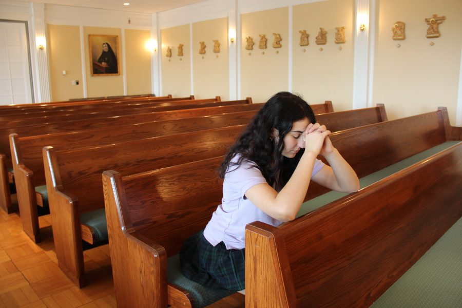 Senior Sophia Mortell confesses her sins before the end of the school year. Juliette Guice '17