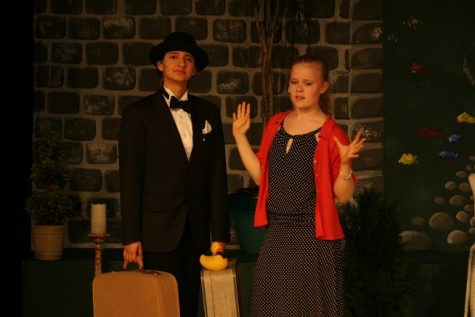 Seniors Nebai Hernandez-Carmona and Lydia Currie perform a scene from Jeeves in Bloom. Courtesy of Miss Danielle Gennaro 05
