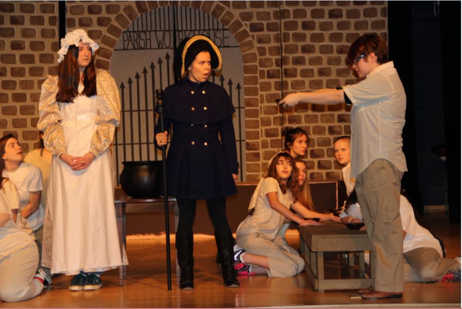 Sacred Heart seniors Emily Casper and Grace Kennedy rehearse a scene in Oliver! with Sacred Heart junior Eva Carrasquero. Izzy Sio 16