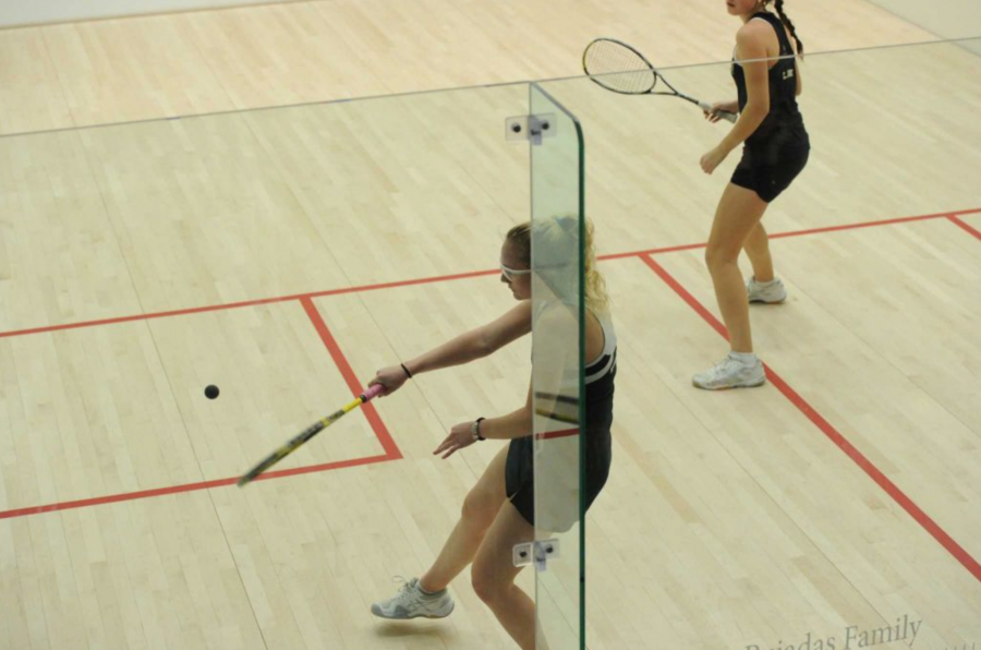 Senior Madison Miles returns the ball in a squash match. Courtesy of Ms. Allamargot