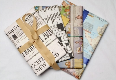 Gifts wrapped in household waste products. Specifically,  newspaper pages, comic pages, and maps are possible alternatives to wrapping paper, courtesy of the.honoluluadvertiser.com