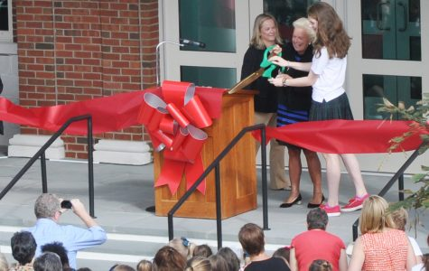 Head of School Mrs. Pamela Juan Hayes '64 and student body president senior Grace Passanante cut the symbolic red ribbon in order to officially open the new athletic complex. Courtesy of cshgreenwich.org