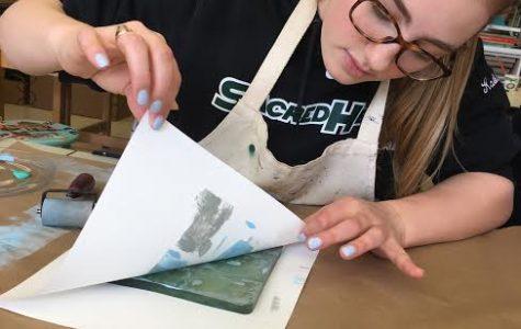 Senior Katie Kablack working on a design project in AP Studio Art. Courtesy of Katie Kablack '17.