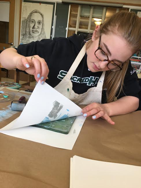 Senior Katie Kablack working on a design project in AP Studio Art. Courtesy of Katie Kablack '17.