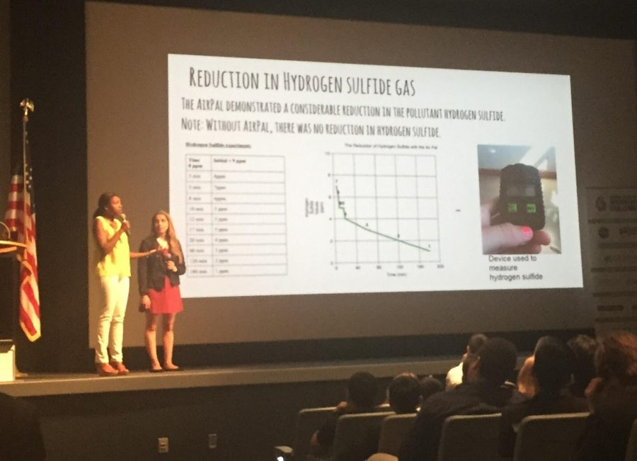 Seniors Yahnah Johns-Woodby and Kensi Almeida present their project to an audience during the final rounds of the competition. Courtesy of Ms. Mary Musolino