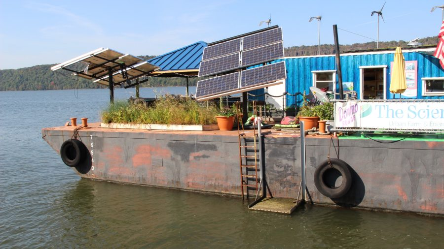 Solar+panels+and+wind+turbines+on+the+barge.+