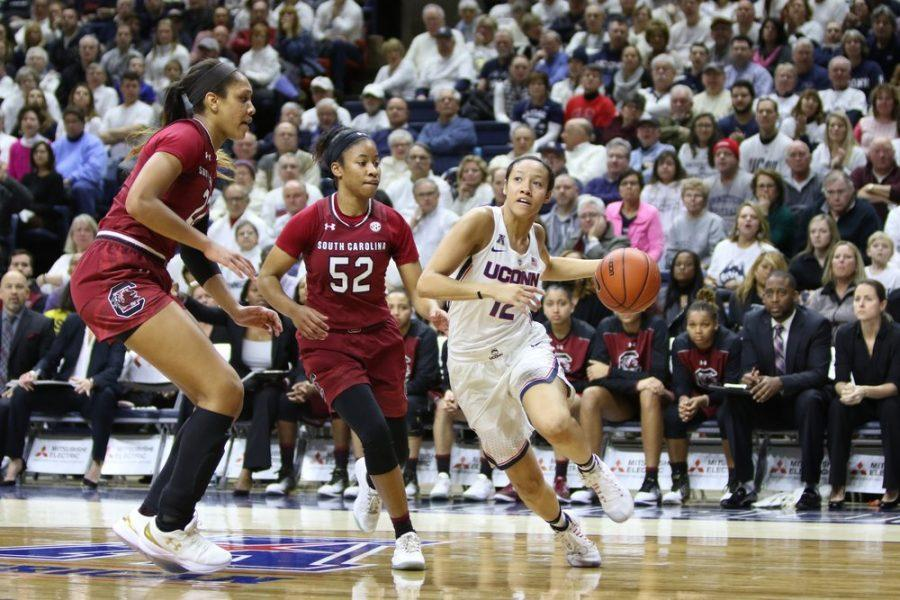 Saniya Chong takes the ball in UConn's game against South Carolina at the Gampel Pavilion. Courtesy of dailycampus.com