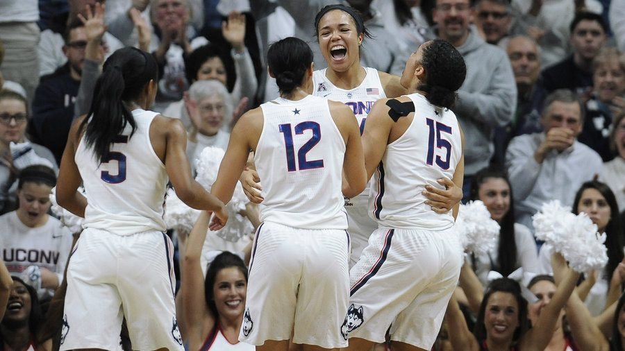 UConn+teammates+celebrate+their+100th+win+together.%0ACourtesy+of+npr.org